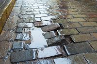 damaged pavement puddle