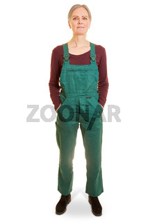 Frau als Arbeiterin in grüner Latzhose