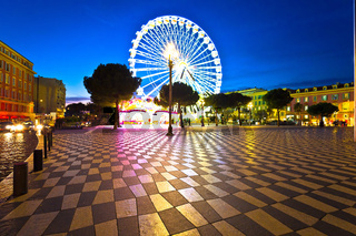 Nice giant ferris wheel and Massena square evening view