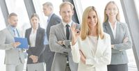 Business people showing ok sign
