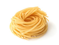 Uncooked tagliolini pasta nest
