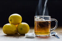 Preparing hot black tea with lemons. Relaxation ,breakfast and health concept.