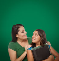 Blank Chalk Board Behind Proud Hispanic Mother and Daughter Student