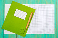 Open school notebook with a and pen