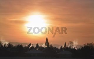 Colorful winter sunrise over village