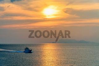 Speedboat returning during the sunset