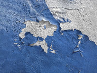 Blue wall with the peeled-off paint