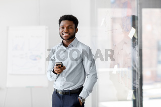 businessman with smartphone at office