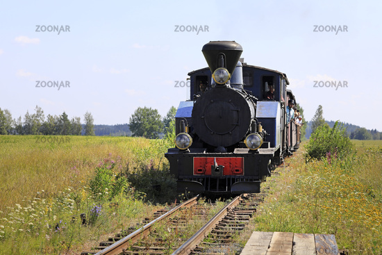 Vintage Locomotive Approaches Flag Stop