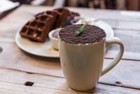 Cup of chocolate mocha with chocolate waffles