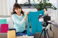 female fashion blogger making blog about shopping