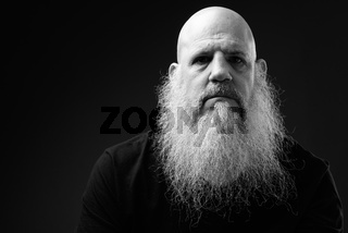 Black And White Portrait Of Mature Bald Man With Long Beard