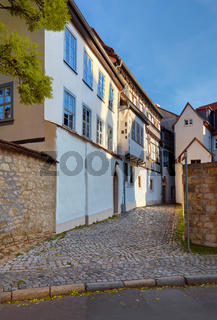 Large three-story white-washed historical timber house in Erfurt, Germany
