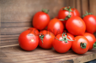 Fresh bright and juicy tomatoes on the kitchen