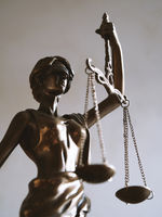 lady justice or justitia figurine - law and jurisdiction symbol