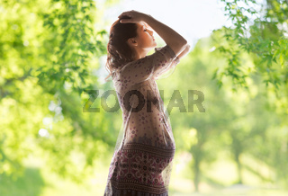 pregnant woman over green natural background