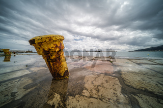 Steel anchoring bollard on the shore