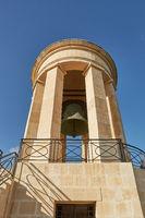 World War II Siege Bell War Memorial from lower viewpoint in the Lower Barrakka Gardens, Valletta, Malta