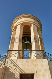 World War II Siege Bell War Memorial from lower viewpoint in the Lower Barrakka Gardens, Valletta, Malta