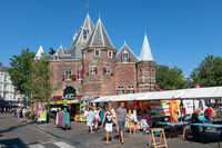 Nieuwmarkt square with people visiting a market, Amsterdam the Netherlands