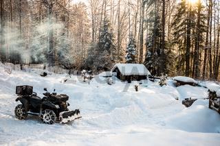 Schneeräumen mit dem Quad in Schweden