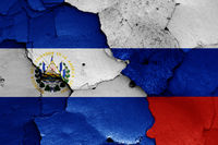 flags of El Salvador and Russia painted on cracked wall