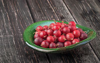 Red gooseberry in clay bowl