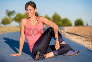 Attractive young woman in sports clothing smiling. Fitness model.