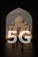 5G text on Taj Mahal India background.