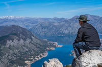 Tourist admiring landscape of Kotor Bay