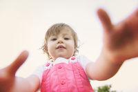 little girl spending time at backyard