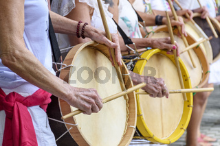 Womans drum players hands and instrument