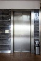 Building Elevator with closed door in apartment complex luxury
