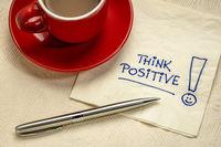 think positive  reminder on a napkin