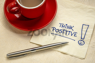 think positive  reminder on a napkin