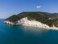 Aerial view of high white cliffs of Vignanotica beach in Apulia region, Italy