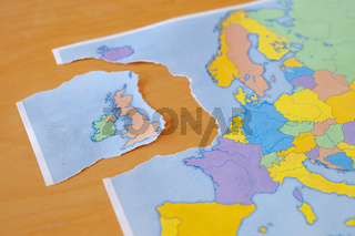 Torn paper map symbolizing the UK leaving the European Union or Brexit