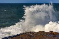 Storm wave breaking on the rocks