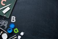 School Supplies On Blackboard