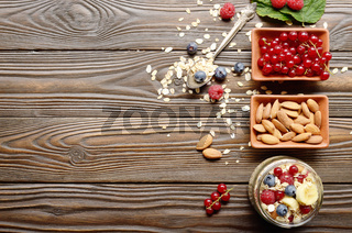 Flat lay top view at Fruit muesli in glass jar on kitchen wooden table