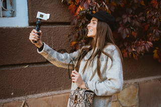 Cute, young female blogger posing on camera.