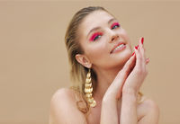 Beautiful model girl with red manicure on nails. Fashion bright make up and cosmetics