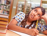 Daydreaming Hispanic Girl Student with Pencil and Books Studying in Library
