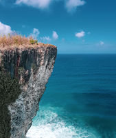 Beautiful cliff over sea and sky background in Bali