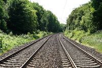 double-track railroad railway or train tracks background with copy space
