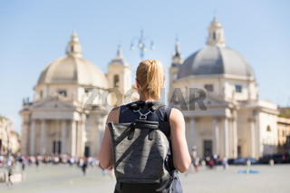 Female tourist with a fashinable vintage hipster backpack on Piazza del Popolo in Rome, Italy.