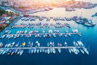 Aerial view of boats, sailboats, yachts at sunset