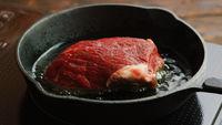 Meat frying on pan