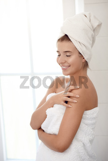Pretty healthy young woman wrapped in white towels