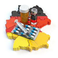 Health, healthcare, medicine and pharmacy in Germany concept. Pills, vials and syringe on the map of Germany isolated on white background.